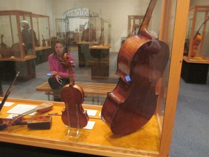 Rare Cello, Violin and bow by Antionio Stradivari.   NOTE:  Granddaughter with heard phones, so we can hear how each instrument sounds when played.