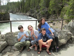 At the head of the YS Falls with 4 of our Grand-wonders:  Teegie's three and our one